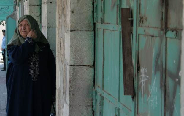 A Palestinian woman hurries hom in the ghostly kasbah
