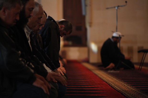 Men at prayer Beirut Grand Mosque Dec 2011