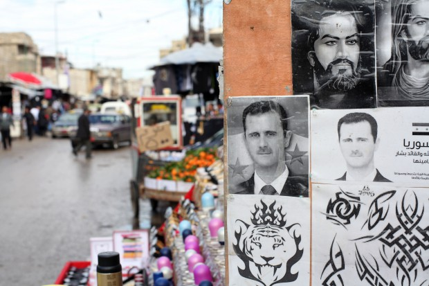 Bashar al Assad tattoos for sale in Palestinian camp