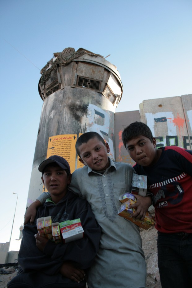 Kids selling sweets at Qalandia